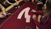 shuffle : Casino: Dealer woman shuffles the poker cards on the table. Casino gamble. Slow motion.