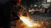 研削 : Man work with Metal processing factory. Sparks.