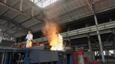 smelting : Man working with liquid metal in factory. Metal factory sparks