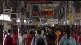 wagons : Kolkata, India - Circa March 2019. Passengers at Howrah railway station, Kolkata, India. Stock Footage