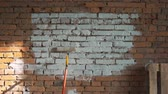 незаконченный : the red-brick walls, shaded white roller to paint. place for logo Стоковые видеозаписи
