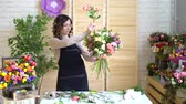 모란 : Beautiful young florist in flower shop