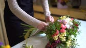 compor : flower composition. Color pink, green, lavander, blue. beautiful luxury bouquet of mixed flowers in woman hand. the work of the florist at a flower shop