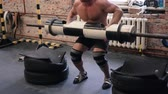 snatch : Athlete going to beat barbell snatch record at the gym with supporting team in slow motion.
