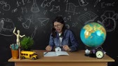sala de aula : Schoolgirl, student sitting at a Desk, doing homework. Education at school, College, University Vídeos