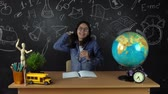 uczennica : Schoolgirl, student sitting at a Desk, doing homework. Education at school, College, University Wideo