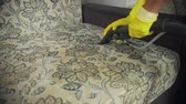 увлажнитель : Cleaning fabric of the sofa with a steam cleaner.