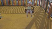 落ち着き : Baby in playground. Smiling baby girl in panama hat having fun riding a chain swing