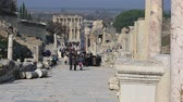 ephesus : tourists visiting columns street ruins of the ancient Ephesus at Turkey Stock Footage