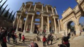 ephesus : tourist visiting ruins Celsius Library in the ancient city of Ephesus in Turkey, wide angle steadicam shoot