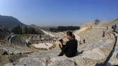 ephesus : tourist use digital tablet in amphitheather of ancient Ephesus Turkey