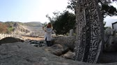 ephesus : attractive blonde tourist taking photo with digital tablet in ruins ancient Ephesus Turkey, steadicam shoot