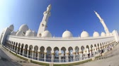 female : tourist and muslim people visiting Sheikh Zayed Grand Mosque in Unated Arab Emirates Abu Dhabi