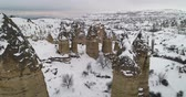 jaskinia : 4K aerial view fairy chimney winter season of Cappadocia Turkey Wideo