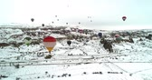 obydlí : 4K aerial hot air balloons flying fairy chimney valley over Cappadocia Turkey at winter season