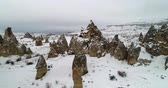mağara : 4K aerial view fairy chimney winter season of Cappadocia Turkey Stok Video