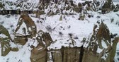 геология : 4K aerial view fairy chimney winter season of Cappadocia Turkey Стоковые видеозаписи