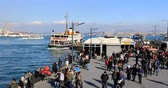vessel traffic : A lot of people in Eminonu. Eminonu, Istanbul, Turkey. Time lapse