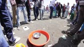 jogos : ADDIS ABABA, ETHIOPIA - JANUARY 19: A group of young people organise unofficial carnival likes games of chance and skill during Timket celebration of Epiphany, on January 19, 2014 in Addis Ababa.