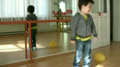 playful : Little Boy playing toys in the kindergarten Stock Footage