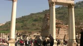 ephesus : 6 february 2014 Tourist group and Temple of Hadrian of Ehhesus ancient city in Selcuk Turkey