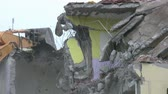 front end loader : bulldozer working at a demolition site