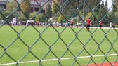 corner : Soccer game behind the fence Stock Footage