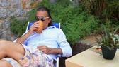 sonhar acordado : Man resting in the garden and drinking coffee