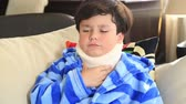 špatně : Portrait of a painful little boy with a neck brace looking at the camera