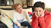punição : Angry mother scolding little son in home interior