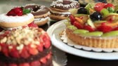 buzlu : Assorted fruit tartlets, donuts and pieces of cakes Stok Video