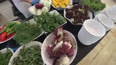 lunchroom : Salad buffet with a many different kinds of vegetables