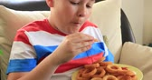 onion ring : Portrait of a cute preteen chld eating onion rings
