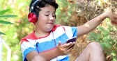 schoolchildren : Portrait of happy young with headphone listening music at the nature