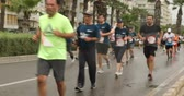 Marathon athletes running on city road