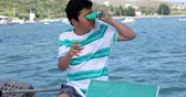 denizci : Portrait of a teenager traveler with binucular looking around on yacht deck at summer vacation