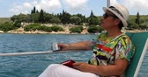 Portrait of a caucasian female tourist woman in glasses  on luxury sailing boat relaxing and looking around at summer vacation
