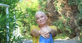 Portrait of asmiling  woman with cancer sitting at the outdoor 動画素材