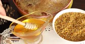 капля : Bowl full of bee pollen with honey comb