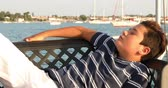 latin american : Portrait of a one young boy relaxing on the yacht deck at summer holiday. Travel people summer concept