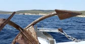 rottami : Boat with old anchor  cruising on the Mediterranean sea