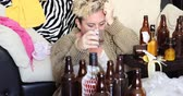 alcoolismo : Middle aged miserable woman in depression, drinking alcohol Vídeos