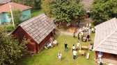 şair : Nahuievychi village, Lviv, Ukraine - August 26, 2018: Celebrating the anniversary of the birthday of the prominent Ukrainian poet Ivan Franko, fair and tourists. Ivan Franko Museum place. Aerial view