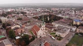 kult : Aerial view of Stryi city architecture with fly around old Church of Our Lady Protectress, Ukraine, 4k Dostupné videozáznamy