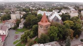 барокко : Aerial view of bell tower and ancient church St. Bartholomew, fly around technique. Drohobych city, center of salt making in Ukraine