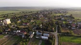 bell tower : Aerial view of village in Western of Ukraine, flight forward with turning left Stock Footage
