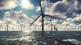 hollandalı : Offshore windmill farm in the ocean, windmills isolated in the ocean on a beautiful Sunny bright day against the blue sky Stok Video