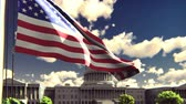 четверть : The American flag flutters in the wind on a Sunny day against the blue sky and the Capitol. The symbol of America and the American national holiday. Стоковые видеозаписи
