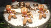peperkoek : Gingerbread men dancing in the middle of a festive Christmas table. The concept of the celebration. Looped Animation.
