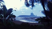 recon : Silhouette of a military nuclear submarine near a deserted tropical island. Beautiful looped background. Stock Footage